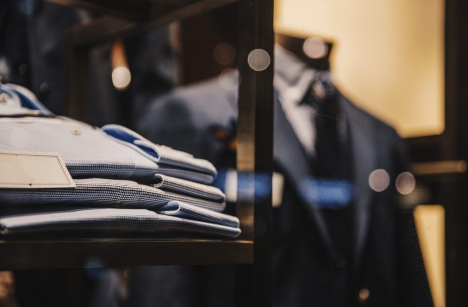 Shirts and suits in a men luxury store